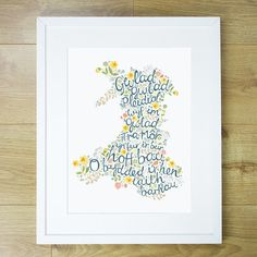 """A beautiful Welsh-as-you-can-get print with a fresh, modern feel that will sit perfectly in amongst your home decor. The text is taken from the chorus of """"Hen Wlad Fy Nhadau"""" - which means 'Land of my Fathers.' welshgiftshop.com"""