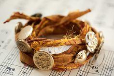 silk shipwrecked bracelet, via Flickr.  sari silk ribbon with buttons