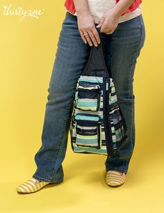 Sling-Back Bag is great for moms on-the-go. Put it over your shoulder and run around hands free!