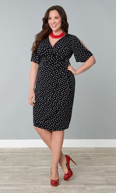 Fall in love with our plus size Haute Cold Shoulder Dress.  This fun dress stays on-trend with cutaway sleeves to keep cool and show some skin without losing coverage.  This faux wrap dress is designed with a functional front panel that allows you to tie the skirt for a custom fit.  #KiyonnaPlusYou  #Plussize  #Kiyonna