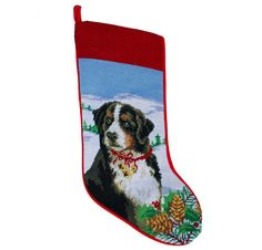 This fabulous stocking is done in the art of needlepointing with wool stitches creating amazing detailed images. The back of the stocking is finished in a lovely holiday red velvet with the front feat