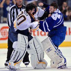 Buffalo Sabres goalie Ryan Miller fights with Toronto Maple Leafs goalie Jonathan Bernier