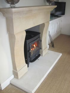 Beautiful Provencale fireplace surround and hearth in Bathstone (surround still a little damp from the quarry).