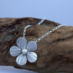 A #floral feel to your jewellery collection with this stunning Sterling Silver Driftwood #Flower Pendant And Necklace. Each petal is delicately #handmade and the texture on the petals of these gorgeous flowers is created using driftwood washed up on the beach, therefore each flower is unique.