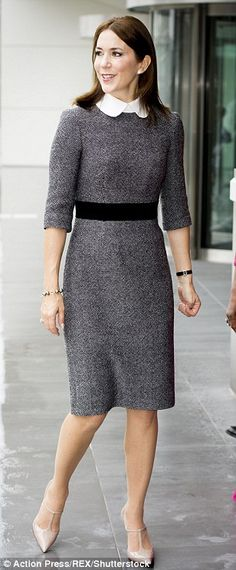 Classic: This tailored dress with a crisp white collar showcased Mary's elegant approach to style on a visit to the International Crime Court in The Netherlands in November