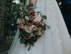 Wedding bouquet with pale, pink flowers.