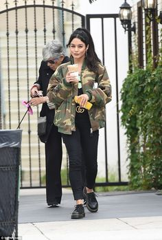 Changing her style: Vanessa Hudgens, 28, went for a much darker than usual look when she stepped out over the weekend to run some errands with some caffeine in hand