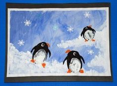 Penguin paintings using potato prints and adding small details