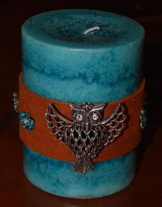 Leather wrapped pillar candle by SugarShakDesigns on Etsy