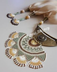 This Pin was discovered by Pam Embroidery Needles, Hand Embroidery, Lace Earrings, Crochet Earrings, Long Silver Hair, Palestinian Embroidery, Thread Jewellery, Point Lace, Tatting