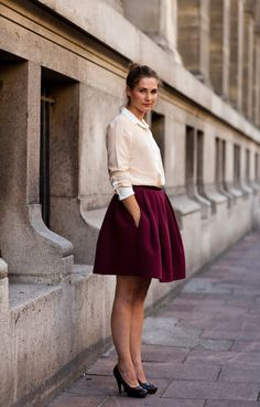 Maroon skirt, layered tan sweater and white blouse