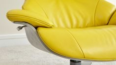Modern Leather eames style reclining armchair with footstool