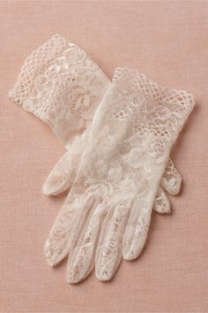 "Heritage Gloves     Fine crochet lace made of flourishes, loops, and wavering lines is cut into a timely yet timeless wrist-grazing silhouette. From Cornelia James, glove maker to none other than Queen Elizabeth II. 9""L. Polyamide-elastane lace. Hand wash. Handmade in UK."