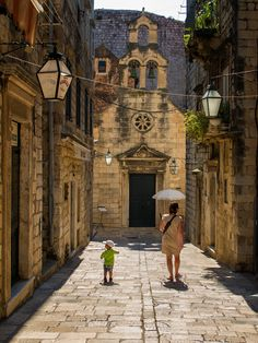 A mother and child strolling along a back street of Dubrovnik Croatia. Dubrovnik is great fun to explore.  See more photos on www.kemrictravelphotography.com