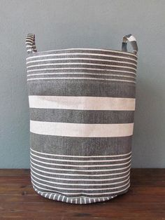 Want a large storage basket/bin in the bedroom for pillows. I'm sure there are great options at HomeGoods.