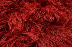 A Super Shaggy rug hand woven with pure wool in red. {Close up} #CustomRugRoom