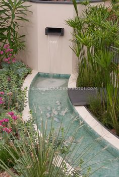 This Waterfall In Modern Water Garden Should Create A Very Relaxing Flowing  Sound.