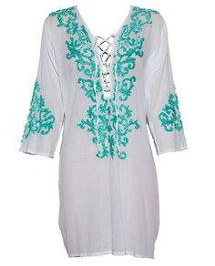 A great beach cover up in crisp white cotton with lacing detail at the front and beautiful turquoise embroidery around the neckline.    Also available in white with  Sand coloured embroidery and in two sizes: s/m or l/xl