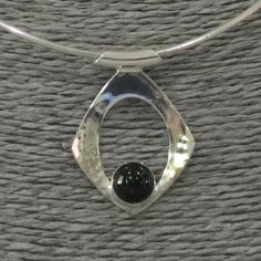 Sterling silver hammered pendant with Onyx cabochon, inspired by the Modernist art movement. Original design, wearable art! Leonardo da Vinci said, Simplicity is the ultimate sophistication I have always worked with simple and dynamic shapes in my fine art painting, and now in