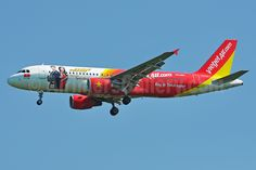 Vietjet Air (VN) Airbus A320-214 VN-A681 aircraft, with the stickers ''SKY BOSS Privilege Flying & Enjoy Flying in Vietnamese'', on short final to Thailand Bangkok Suvarnabhumi International Airport.