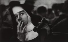 W. Eugene Smith - USA. New York City Harbour. Nun waiting for survivors of the Andrea Doria sinking