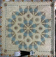 This is unbelievable - hover over the quilt with your cursor to see detail and there is a video below it, describing how it was made.