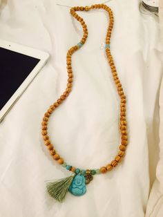 I'm now making Mala's.  Wood, Jade, Ammanozite, Brass shown in this picture. $52 Total *this Mala is Sold  Go to JewelsbyLP.com/Facebook  Please private message with your color choices.