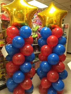 Fun balloon columns for a wonder woman party! Order today at Dollat Party! #ballooncolumn #balloons #balloondelivery