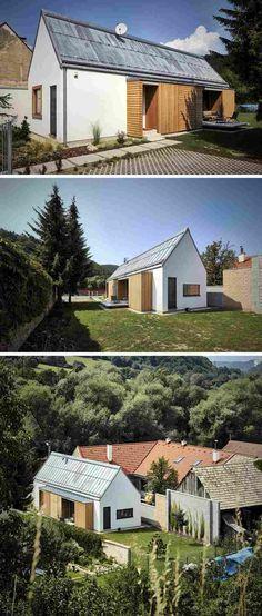 façade de maison design en blanc neige, portes extérieures en bois massif et paysage forestier