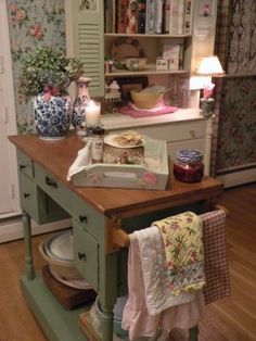 Desk turned into kitchen island, what a great idea!   We'd utilize a less is more approach to the surrounding decor though...