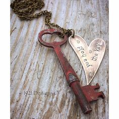 Antique skeleton key hand painted and distressed on brass chain with simple hand stamped brass piece you hold the key. Key measures just over 2 1/2.