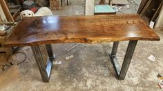 This beautiful live edge Walnut and steel Dining table should should sit  nicely in its new setting. Www.sonnetinteriors.co.uk