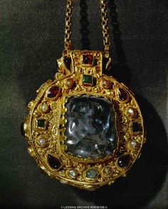 CAROLINGIAN AMULET 9TH  Charlemagne's talisman, sapphire in gold setting with jewels and pearls, found in the Emperor's tomb in Aachen (Aix-la-Chapelle), Germany.