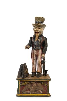 UNCLE SAM Mechanical Bank painted case iron money box, 28cm high / MAD on Collections - Browse and find over 10,000 categories of collectables from around the world - antiques, stamps, coins, memorabilia, art, bottles, jewellery, furniture, medals, toys and more at madoncollections.com. Free to view - Free to Register - Visit today. #MoneyBanks #MADonCollections #MADonC
