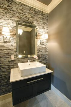 Half bathroom accent wall idea - rough tile wall Like the color and the idea of stone