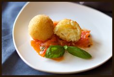 arancini with mozzarella in herby tomato sauce... had these in italy and want them again @Therese  Dalla Riva
