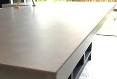 Polished concrete island and worktops in our true colour made made by us at Toncrete Tuesdays.