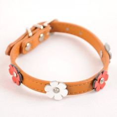 Brown Flower Collar - Constructed with soft leather and quality hardware, the Flower Collar is accented with four cutout flowers dotted with a center rhinestone. #dogproducts #dogsupplies #dogaccessories #dogcollar http://BeesCorner.com/brown-flower-collar/
