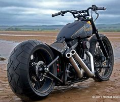 matte gray harley softail-based custom bobber