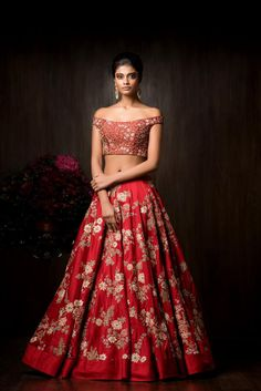 Deep red choli with off shoulder blouse could make a perfect indian wedding dress; If you're having a traditional indian wedding ceremony, opt for a veil that will cover some of your shoulder. Or, use this look for your Indian wedding reception dress
