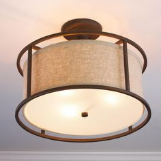 """Springfield Drum Shade Semi Flush Ceiling Light The popular drum shade look is framed within a metal cage of Bronze with beige linen shade or Polished or Satin Nickel with a white linen shade. Frosted glass diffuser on bottom softens the light. 3x60 watts (medium base socket). (13""""Hx17""""W) $249"""
