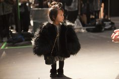 this child has a chanel bag and is backstage at the Alexander Wang show... I am stealing her