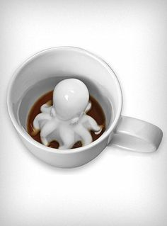 While the octopus is a steampunk dream - I would love to sip down and see this little guy slowly poking through the coffee fog.