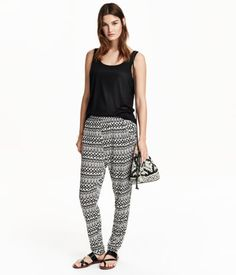Soft jersey pants with a printed pattern. Elasticized waistband, dropped gusset, and side pockets.