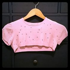 NWOT super cropped short sleeve sweater Adorable extremely soft cropped sweater. Beautiful color pink with pink sequins and pink Swarovski crystals. This sweater does not cover bust falls just above cleavage. Feels like cashmere but is made up of 90% rayon 5% nylon 5% spandex.... no pulls no tears never worn easel Tops