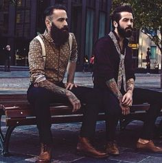 two stylish beards on a bench - full thick dark beard bearded man men mens' street style hair boots suspenders tattooed tattoos #beardsunited #beardsforever