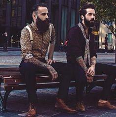two stylish beards on a bench - full thick dark beard bearded man men mens' street style hair boots suspenders tattooed tattoos #beardsunited #beardsforever