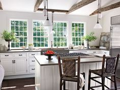 Use a white-and-gray palette to help a kitchen feel open and airy.