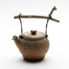 Cornelia Trösch. wood fired teapot with branch handle