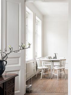 dining area, white on white.